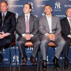 President Randy Levine, GM Brian Cashman, manager Joe Girardi and COO Lonn Trost lined up alphabetically by height for the press conference annoucing the obviously exciting acquisition of relief hurler Rafael Soriano.
