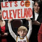 With the LeBron-less Cavaliers staggering along on an 18-game losing skid, this young fan at Quicken Loans Arena wisely urged the city's fair people to simply get up and leave their woeful NBA team to its own sad devices.