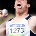 The metallic orb in his right hand obviously imparted a performance-enhancing charge of some kind (like the one  SEEN HERE ) to this competitor at the IPC Athletics Championships in Christchurch, New Zealand.
