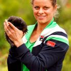 The Belgian tennis siren, whose chest size was the subject of  much public speculation this week , took time for a meet-and-greet with an Echidna ( CLICK HERE for footage of one in action ) at the Australian Open.