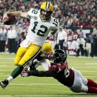 Rodgers threw three touchdown passes, ran for another score and led the Packers to their second straight postseason road victory with a stunning rout of the top-seeded Falcons. Rodgers completed 31-of-36 passes for 366 yards.