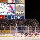 """An estimated crowd of 70,000 braved the elements in Pittsburgh. Capitals fans had a heavy turnout, as NBC announcers estimated there were about 30,000 wearing Washington's red and white. At one point, fans from both teams chanted """"Flyers suck"""" in unison."""