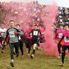 A nice way to raise breast cancer awareness by having competitors dodge clouds of pink tear gas...
