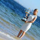 In one of the week's more arresting sights, the Australian Open women's singles champion waded out of the surf at Brighton Beach clad in evening wear and bearing what appears to be an ornate crockpot....