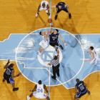 Duke's Josh McRoberts and North Carolina's Tyler Hansbrough fight for possession during the opening tip of a Duke-UNC game in Chapel Hill.