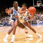 Michael Jordan smothers Duke guard Tommy Amaker. During his three seasons with the Tar Heels, Jordan averaged 18 points and five rebounds per game.