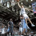 Mike Dunleavy Jr. dunks over Jason Capel. The Duke forward averaged 17 points and 7 rebounds per game in the Blue Devils' 2001 championship season.