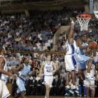 Rashad McCants tries to convert a reverse layup over the outstretched arms of Shelden Williams. McCants is currently out of the NBA after playing four seasons for the Timberwolves and Kings.