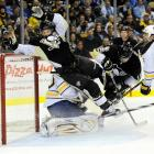 Pittsburgh's Kris Letang crashes into Buffalo Sabres goalie Ryan Miller during the second period of the Penguins' 3-2 win on Feb. 4 at the Consol Energy Center in Pittsburgh.