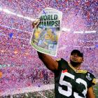 Diyral Briggs spreads the news of the Packers' win at Super Bowl XLV at Cowboys Stadium in Arlington.