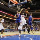 Philadelphia's Elton Brand muscles past Danilo Gallinari and Shawne Williams during a 100-98 victory over the Knicks on Feb. 4 at  the Wells Fargo Center in Philadelphia.