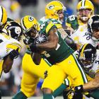 Green Bay running back James Starks fights through a gang of Steelers tacklers during the first quarter.