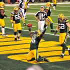 Packers safety Nick Collins extends his arms into the air after recording a pick-six in the first quarter.