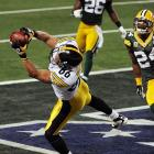Shortly before the end of the first half, Steelers wide receiver Hines Ward reels in a touchdown pass from Ben Roethlisberger to make it 21-10.
