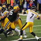 Steelers quarterback Ben Roethlisberger is hit in the end zone leading to a 37-yard interception return for a touchdown by Packers safety Nick Collins.
