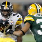 Steelers running back Rashard Mendenhall takes on Packers cornerback Tramon Williams in the second quarter.