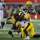 Packers running back James Starks fights through a tackle in the middle of the second quarter.
