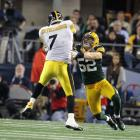 Steelers quarterback Ben Roethlisberger is rocked by Packers linebacker Clay Matthews in the second quarter.