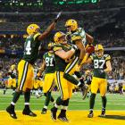 Packers wide receiver Greg Jennings celebrates with his teammates after catching a 21-yard touchdown pass in the second quarter.