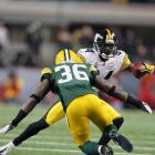 Steelers wide receiver Antonio Brown attempts to elude Packers safety Nick Collins.