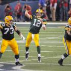 Aaron Rodgers drops back into the pocket and throws a pass during the second quarter.