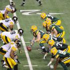 Aaron Rodgers and the Packers' offense prepares to snap the ball against the Steelers' defense.