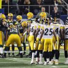 The Packers offense and the Steelers defense huddles up before a play in the third quarter.