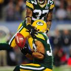 Packers cornerback and return man Tramon Williams bobbles a punt during the first quarter of Super Bowl XLV. Green Bay recovered the fumble.