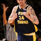 West Virginia center Kevin Pittsnogle celebrates after hitting a three-pointer against Boston College during the second round of the Big East tournament. West Virginia won the game 78-72 and advanced to the Elite Eight in the NCAA tournament that year.