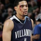 Scottie Reynolds of Villanova heads to get treatment during an 82-63 loss to Georgetown in the 2008 tournament.