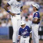 Kareem Abdul-Jabbar and Charlie Sheen, who's 5-10, meet at the pitcher's mound during the 1991 Hollywood All-Stars baseball game.