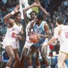 North Carolina forward James Worthy tries to find some daylight amid a swarm of Maryland defenders.