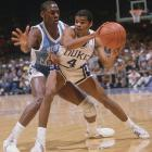 Michael Jordan swarms Duke guard Tommy Amaker during a matchup between the Blue Devils and Tar Heels.