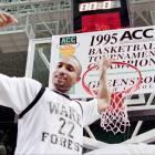 Wake Forest's Randolph Childress celebrates at the Greensboro Coliseum after the Demon Deacons defeated North Carolina 82-80, in overtime, to win the ACC title. Childress scored 37 points and was named the tournament's MVP.