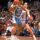 Forward J.R. Reid looks for an open man over the shoulder of Duke defender Danny Ferry. Reid would earn MVP honors as he led the Tar Heels to a tournament victory.