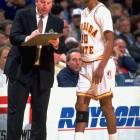 Florida State coach Pat Kennedy speaks with point guard Sam Cassell during a game against Clemson.