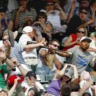 It was bat day in fabulous Kissimmee, Fla., as Atlanta's Dan Uggla sent his stick flying into the crowd where it was deftly snatched by one Mr. Mitch Davie (center right) of Brooklyn, NY, without spilling his beverage.