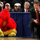 Morehead State, indeed. Louisville's head coach and his assistant held theirs more in a state of disbelief as their NCAA Tournament game in Denver went to pot.