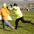 Protester With Sign upset heavy favorite Charging Bobby at England's Cheltenham Racecourse on March 17.