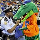 """""""Move along or I'll run you in!"""" According to our police wire, the Gator was issued a summons for violating a New Orleans' ordinance that prohibits large, semi-aquatic, ectothermic, carnivorous reptiles from attending NCAA tournament basketball games."""