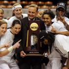 """Associate head coach Vic Schaefer (middle), nicknamed the """"Secretary of Defense,"""" has spent 14 seasons working under Blair, dating back to their time at Arkansas. Blair turned over control of his defense to Schaefer, and the unit was crucial to this year's championship run. In the tournament, the Aggies held opponents to 51 points per game."""