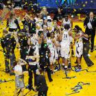 Confetti falls as media member move toward the latest national champion. The second-seeded Aggies beat Baylor for the first time in four tries to reach the Final Four and downed Stanford in the final seconds on their unexpected run.