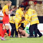 The security staff at Australia's Adelaide Oval looked, with some understandable reluctance, for the handles on a streaker who aired his views during a game between England and Argentina on April 2.