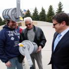 The legendary Brewers broadcaster (center) and the team's proud owner (right) paused to marvel at the latest in innovative suds-delivery technology as proferred by one Mr. Jeff Kahlow (left) before the home opener (not the bottle opener) at appropriately-named Miller Park in Milwaukee.