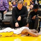 The carcass of the Laker superduperstar lay in state at Staples Center after a run-in with a row of courtside seats during a basketball game against the Hornets (the team, not the flying insects) at Staples Center.