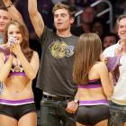 Surrounded by scantily-clad damsels, the noted actor-warbler-hoofer signaled for another sarsparilla while NBA action between the New Orleans Hornets and the Los Angeles Lakers raged on at Staples Center in LA.