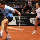"""Sabine Lisicki watches in obvious alarm as Carl-Uwe Steeb suffers an underwear malfunction during a """"show match"""" against Henri Leconte and Barbara Rittner in Stuttgart, Germany."""