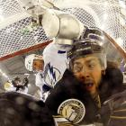 The Penguin and Lightning blueliners go after spare change that fell out of Pittsburgh netminder Marc-Andre Fleury's pants pockets during Game 7 of their NHL Eastern Conference Quarterfinals hockey game at Consol Energy Center in Pittsburgh on April 27.