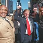 Boxers George Foreman and Shannon Briggs hold Trump's arms during a news conference. Briggs won a controversial majority decision against Foreman a month later in a heavyweight fight at Trump's Taj Mahal in Atlantic City.