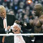 """Trump prepares to shave the head of WWE chairman Vince McMahon, who is being held by """"Stone Cold"""" Steve Austin, in April 2007 at Wrestlemania 23 in Detroit. Trump had put his famous hair on the line in the """"Battle of the Billionaires"""" with McMahon. Bobby Lashley, representing Trump, beat McMahon's Umaga, sparing The Donald's coif."""